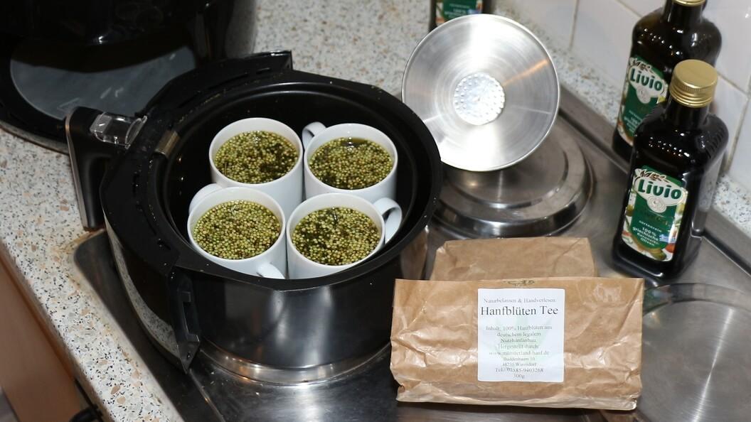Hanföl machen, backen und Cannabis essen – vier Tassen mit Olivenöl und Hanftee