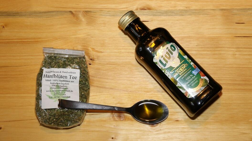 Hanfblütentee, Olivenöl und davor das Hanföl auf einem Esslöffel
